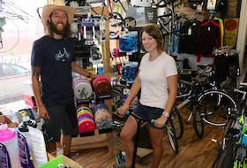 Spoke & Note business owner Tony Wood, pictured with his wife Ashley Wood, enjoys cycling and would like to see the province make Falmouth's Bog Road more bicycle friendly.