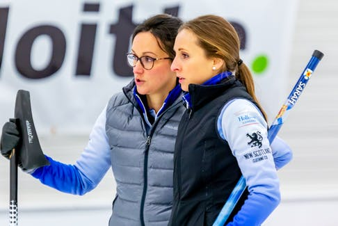 Third stone Erin Carmody, right, and skip Jill Brothers discuss strategy during the 2019 Nova Scotia women's curling championship in Dartmouth. Team Brothers is competing this week in the Canadian Curling Pre-Trials Direct-Entry Event in Ottawa, Ont. Carmody grew up in Summerside and is a product of the junior curling program at the Silver Fox Entertainment Complex.