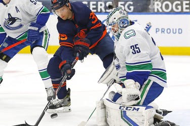 Winger Alex Chiasson, jamming the net against Canucks goalie Thatcher Demko last season, has joined the Canucks on a professional tryout basis. He scored nine goals in 45 games last year for the Edmonton Oilers.