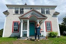 Kellianne Land outside of her Acadian farmhouse in Wedgeport.