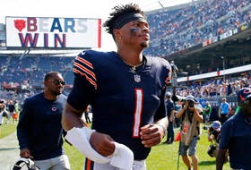 Chicago Bears quarterback Justin Fields runs off the field after his team's 20-17 win over the Cincinnati Bengals at Soldier Field on Sept. 19, 2021.