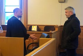 Kurt Churchill (right), talks with his lawyer Robby Ash during a previous court appearance. FIle photo