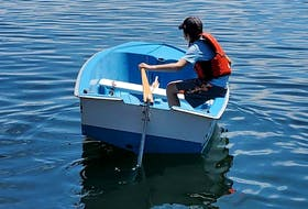 """Nine-year-old Ransom Chetwynd does his """"rudder waggle"""" to get used to it before putting a sail on The Meg, the nine-foot sailing dinghy he bought himself by collecting bottles and doing odd chores. Contributed"""