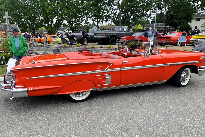The Rio Red 1958 Chevrolet Impala — just one of many, many sweet collector and classic cars at the show — has all the extras. Alyn Edwards/Postmedia News