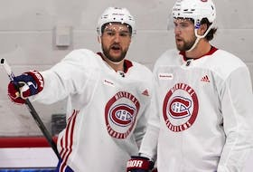 Jonathan Drouin (left) and Josh Anderson chat Thursday morning as the Canadiens hit the ice for the first time during training camp at the Bell Sports Complex in Brossard.