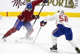 Montreal Canadiens' Jake Evans battles David Savard during training camp in Brossard on Sept. 24, 2021.