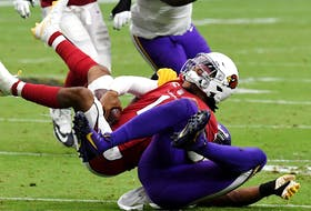 Quarterback Kyler Murray #1 of the Arizona Cardinals is sacked in the fourth quarter of the game against the Minnesota Vikings in Week 2.