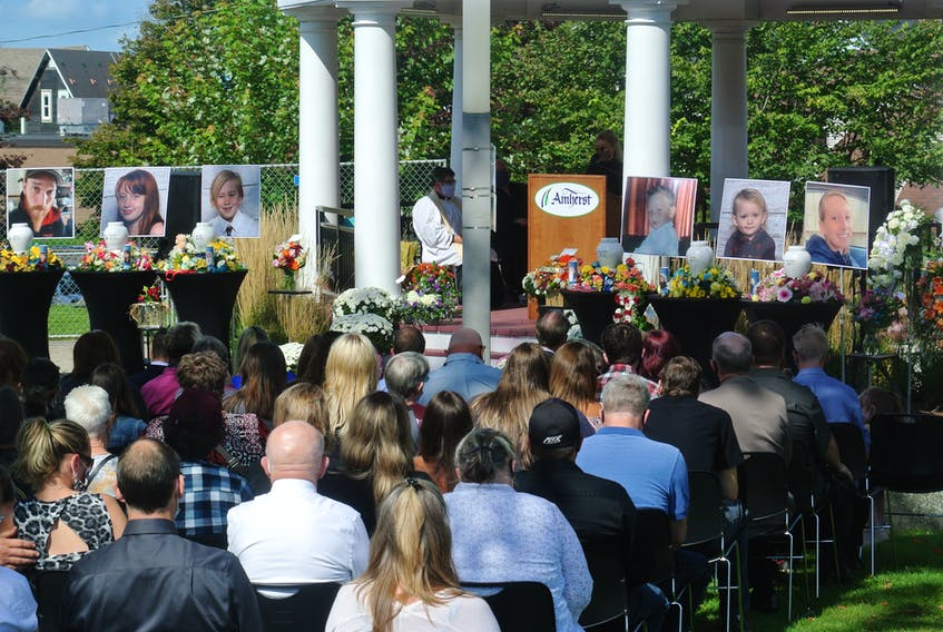 A crowd of family and friends listens as Molly Ferdinand delivers a eulogy during the funeral Friday for six members of the Amherst family who lost their lives in a tragic fire in Millvale on Sept. 12. Darrell Cole-SaltWire Network