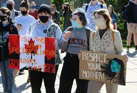Some of the MUN students who attended the  Fridays For Future Global Climate Strike rally at MUN were (from left) Desire Nicholl, Emily Stevens and Morgan Winter. -Joe Gibbons/The Telegram