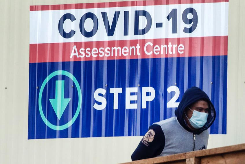 People enter a COVID-19 Assessment Centre in Scarborough, Ont.