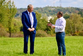 Minister of Municipal Affairs and Housing John Lohr speaks with West Hants Mayor Abraham Zebian following a provincial funding announcement Sept. 24 that will see equalization payments doubled this year.