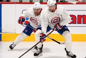 Montreal Canadiens' Jonathan Drouin, left, and Josh Anderson scrimmage during training camp on Sept. 23, 2021, in Brossard.