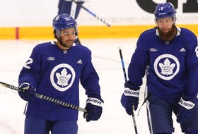 Toronto Maple Leafs Jake Muzzin (right) with newcomer Josh Ho-Sang on the first day of on ice activity at training camp in Toronto on Thursday. Jack Boland/Toronto Sun