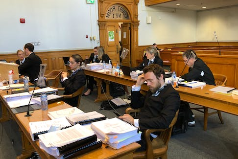 Lawyers representing the Innu Nation, the federal government and the provincial government wait for Newfoundland and Labrador Supreme Court Justice Sandy MacDonald to enter the courtroom in St. John's Sept. 17.