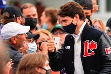 Prime Minister Justin Trudeau greets supporters gathered in Quidi Vidi Village, N.L.  during a campaign stop in Newfoundland Aug. 23. Keith Gosse • SaltWire Network