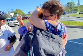 Shelburne resident Amanda Stoddard is hugged by a recipient of a winter care package. Stoddard and five friends delivered 50 winter care packages to individuals living on the streets of Halifax and homeless shelters on Sept. 11.  Contributed