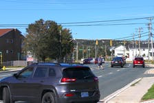 A man crosses the four lanes of Thorburn Road less than 100 feet from a crosswalk. RNC identified this general area as where a female pedestrian was killed when she was struck by a vehicle last Sunday morning.