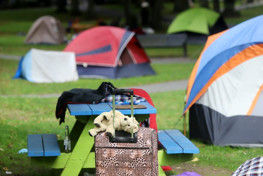 A teddy bear sits on some luggage, outside one of the tents, housing the unhoused, in Victoria Park in Halifax Friday September 24, 2021.TIM KROCHAK PHOTO