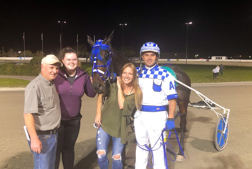 Driver Adam Merner, right, celebrates career win No. 500 on Sept. 23. Merner teamed up with Ms Moyse for the milestone win at Red Shores Racetrack and Casino at the Charlottetown Driving Park. From left, breeder Eldred Nicholson, co-owner Olivia May and namesake Olympic gold-medallist Heather Moyse. Red Shores Photo
