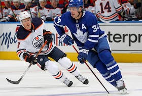 Kyle Turris (No. 8) of the Edmonton Oilers skates to check Auston Matthews (No. 34) of the Toronto Maple Leafs during an NHL game at Scotiabank Arena on January 20, 2021 in Toronto.