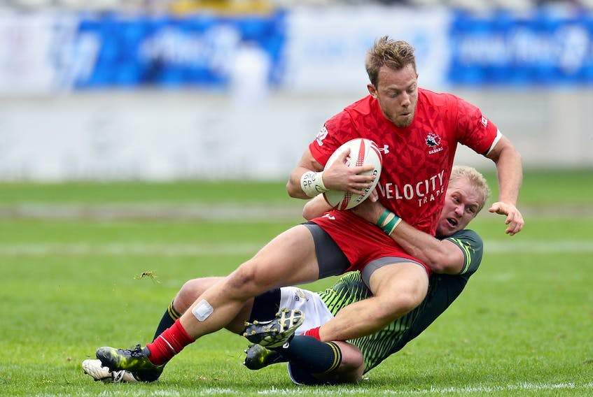 Harry Jones of Canada is tackled by Tim Anstee of Australia during the HSBC Rugby Sevens match between Australia and Canada on May 13, 2017, in Paris.