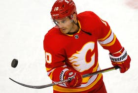 Derek Ryan warms up with the Calgary Flames prior to taking on the Ottawa Senators at the Scotiabank Saddledome in Calgary on May 9, 2021.