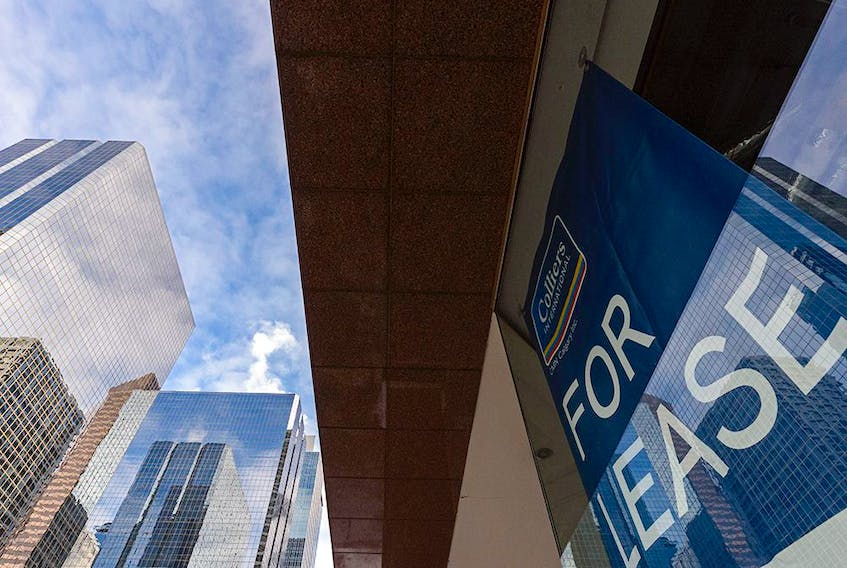 With the high office vacancy rate in downtown Calgary, lease signs are a common sight.