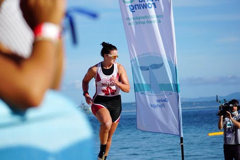 Canada's Brienne Miller races to the finish line to capture the gold medal at the women's solo (CW1x) division at the World Rowing Coastal and Beach Championships in Oeiras, Portugal, on Sunday. - World Rowing