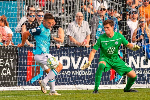 Stefan Karajovanovic (left) of the HFX Wanderers makes a save while keeper Kieran Baskett looks on during a Canadian Premier League match Saturday afternoon at the Wanderers Grounds. - Trevor MacMillan / CANADIAN PREMIER LEAGUE