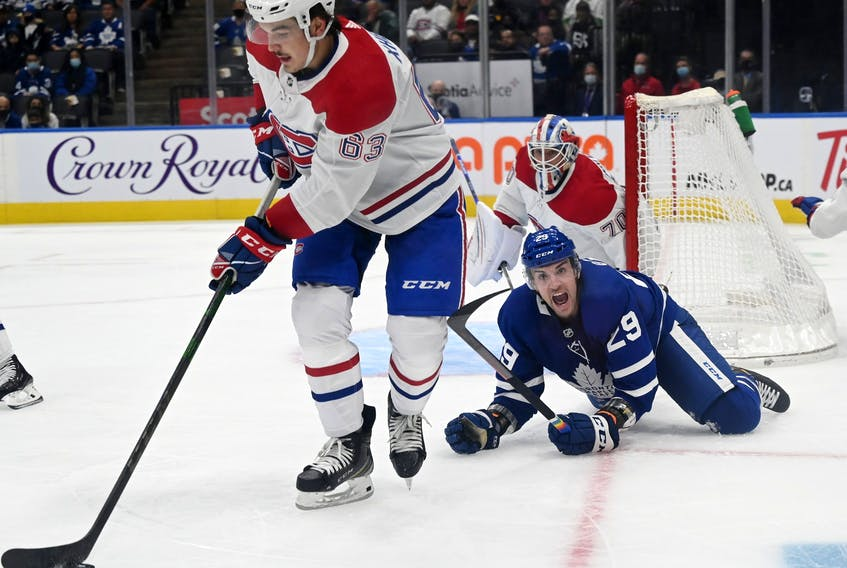 Maple Leafs forward Kurtis Gabriel (back) yells at the referee that he had been tripped by Montreal Canadiens' Arber Xhekaj during pre-season action on Saturday night.