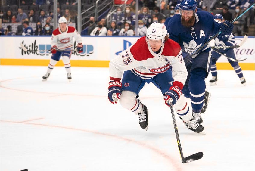 Maple Leafs defenceman Jake Muzzin (8) battles for the puck with Montreal Canadiens' Tyler Toffoli (73) during the first period at Scotiabank Arena in Toronto on Saturday, Sept. 25, 2021.