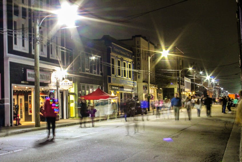 Passers-by wander up and down Charlotte St. at Lumière Cape Breton's 2021 Art-at-Night festival on Saturday. JESSICA SMITH/CAPE BRETON POST