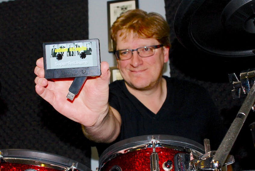 """While Adam Staple's album """"SuperAntiHero"""" is available on all major streaming platforms, he also had these USB cassettes made for purchase. A musician in St. John's for 30 years, this is his first solo recording project of original material."""