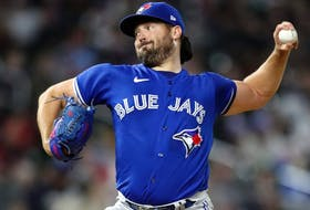 Blue Jays pitcher Robbie Ray delivers a pitch to the plate against the Twins in the second inning at Target Field in Minneapolis, Sept. 25, 2021.