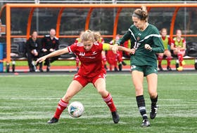 Memorial's Katie Joyce fends off Cape Breton's Caleigh Macpherson during AUS women's soccer action in Sydney, N.S., on Saturday. Joyce and the Sea-Hawks were held off the scoresheet in a 1-0 loss to the Capers, but bounced back for a 2-0 win over previously undefeated St.FX on Sunday, with Joyce scoring one of Memorial's goals. —CBU Athletics