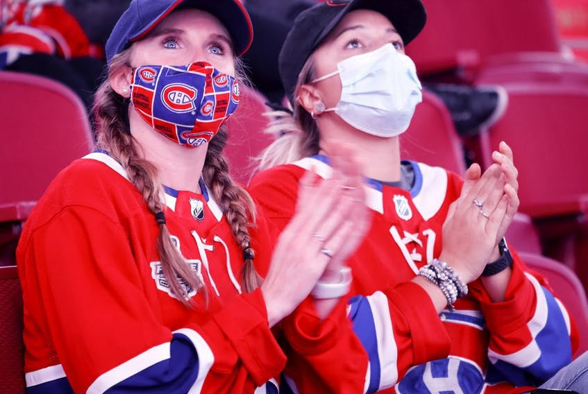 Two Habs fans cheers as the Montreal Canadiens are introduced for the annual Red vs White scrimmage in Montreal, on Sunday, Sept. 26, 2021.