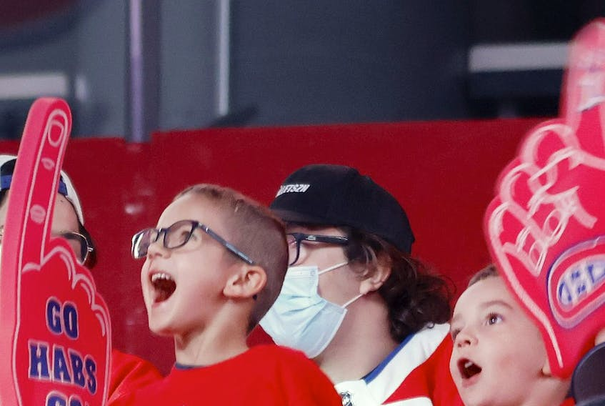 Young Habs fans cheer as the Montreal Canadiens are introduced for a Red vs. White scrimmage at the Bell Centre on Sept. 26, 2021.