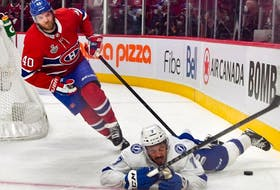 Joel Armia of the Montreal Canadiens is called for a tripping penalty on Mathieu Joseph of the Tampa Bay Lightning during the second period in Game Four of the 2021 NHL Stanley Cup Final at the Bell Centre on July 05, 2021 in Montreal, Quebec, Canada.