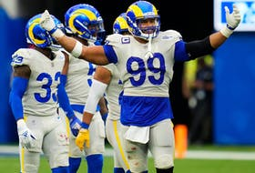 Los Angeles Rams defensive lineman Aaron Donald is all smiles as he gestures to the crowd during Sunday's win over Tampa Bay.
