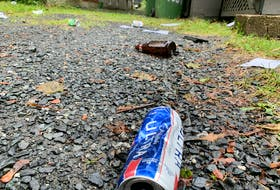 Sept. 26,2021 - Discarded beer cans and bottles still litter some properties on Larch Street on Sunday, the day after a massive street party.