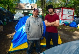 John Walter Griffin (left) and Nate Thorburne pose for a photo in the People's Park in west end Halifax on Monday, Sept. 27, 2021. Griffin and Thorburne have both been living in the park for the last few weeks.