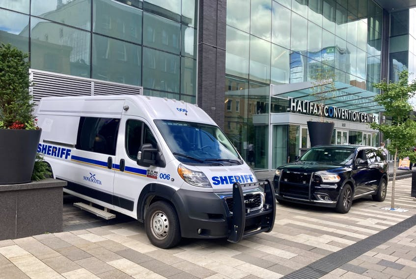 Sheriff's vehicles were parked Monday outside the Halifax Convention Centre, where six men are on trial in Nova Scotia Supreme Court for allegedly attempting to murder a fellow inmate at the Dartmouth jail in December 2019.