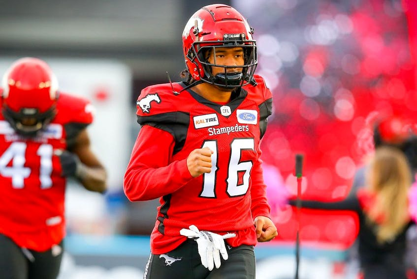 Royce Metchie of the Calgary Stampeders runs onto the field during player introductions before facing the Winnipeg Blue Bombers in CFL football on Saturday, October 19, 2019. Al Charest/Postmedia