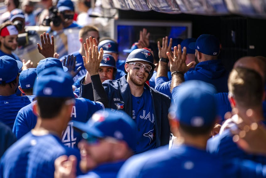 Blue Jays' Danny Jansen celebrates with teammates while wearing the blue Home Run Jacket after hitting a three-run home run in the second inning against the Minnesota Twins at Target Field on Sept. 26, 2021 in Minneapolis. Stephen Maturen/Getty Images