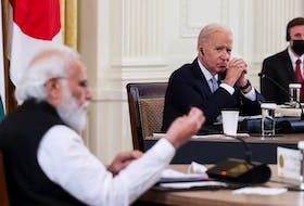 U.S. President Joe Biden listens as India's Prime Minister Narendra Modi speaks during a Quad nations meeting at the Leaders' Summit of the Quadrilateral Framework held in the East Room at the White House in Washington, Sept. 24.
