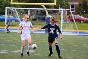 Holly O'Neill (left) and the Memorial Sea-Hawks are solidly in a playoff position in AUS women's soccer after a 2-0 win over the St. FX X-Women on Sunday. — Kendra Vigneau/St. FX Athletics