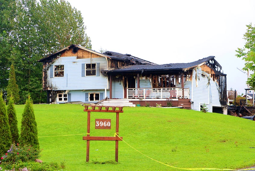 Firefighters responded to a structure fire at a home on Prospect Road in North Alton on Sept. 25. Adrian Johnstone