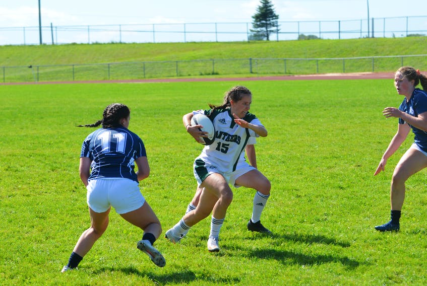 The UPEI Panthers' Kendal Brooks, 15, carries the ball during an Atlantic University Sport women's rugby game against the St. Francis Xavier X-Women in Charlottetown on Sept. 11. Brooks scored a try in the Panthers' 32-0 road win over the Saint Mary's Huskies on Sept. 25.