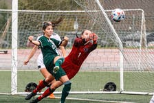 UNB Reds keeper Brynn Nash punches the ball out of harm's way while the UPEI Panthers' Tyffanie Bordage focuses on making contact with the ball. The teams played to a 1-1 tie in an Atlantic University Sport women's soccer game at UNBSJ's Canada Games Stadium on Sept. 28. Kevin Barrett Photo/For UNB Athletics