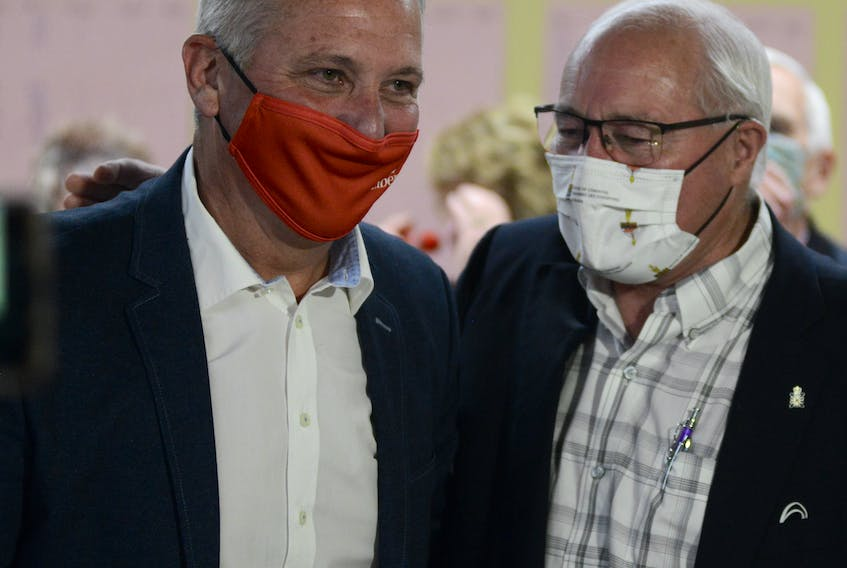 Wayne Easter, right, talks with Heath MacDonald on election night, Sept. 20, at the North River Fire Hall. MacDonald won the Malpeque riding for the Liberals after Easter decided not to run again. Easter, who served the riding for almost 28 years will receive close to $130,000 in an annual pension, courtesy of Canadian taxpayers.